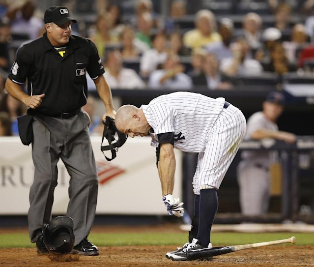New York Yankees' Brett Gardner reacts to his ejection by home plate umpire Tim Timmons for tossing his helmet after Timmons called Gardner out on strikes to end the fifth inning of the Yankees' baseball game against the Boston Red Sox at Yankee Stadium in New York, Tuesday, Sept. 2, 2014 (AP Photo/Kathy Willens)