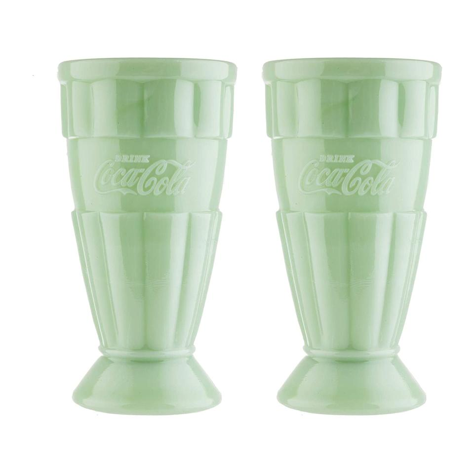 """<p>Another from the Coca-Cola collection, these malt glasses are just begging to be filled with a root beer float or one of our <a href=""""https://www.southernliving.com/recipes/tenntucky-blackberry-cobbler"""" rel=""""nofollow noopener"""" target=""""_blank"""" data-ylk=""""slk:Tenntucky Blackberry Cobbler Sundaes"""" class=""""link rapid-noclick-resp"""">Tenntucky Blackberry Cobbler Sundaes</a>.</p> <p><strong>Buy It: $59.99; <a href=""""https://www.amazon.com/TableCrafts-Coca-Cola-Jadeite-Malt-Green/dp/B07P5WFSLN/ref=as_li_ss_tl?ie=UTF8&linkCode=ll1&tag=slhomejadeitekitchentrendkyarborough0820-20&linkId=332e6cb7ddf0baf04965efb46eb0f497&language=en_US"""" rel=""""nofollow noopener"""" target=""""_blank"""" data-ylk=""""slk:amazon.com"""" class=""""link rapid-noclick-resp"""">amazon.com</a></strong></p>"""