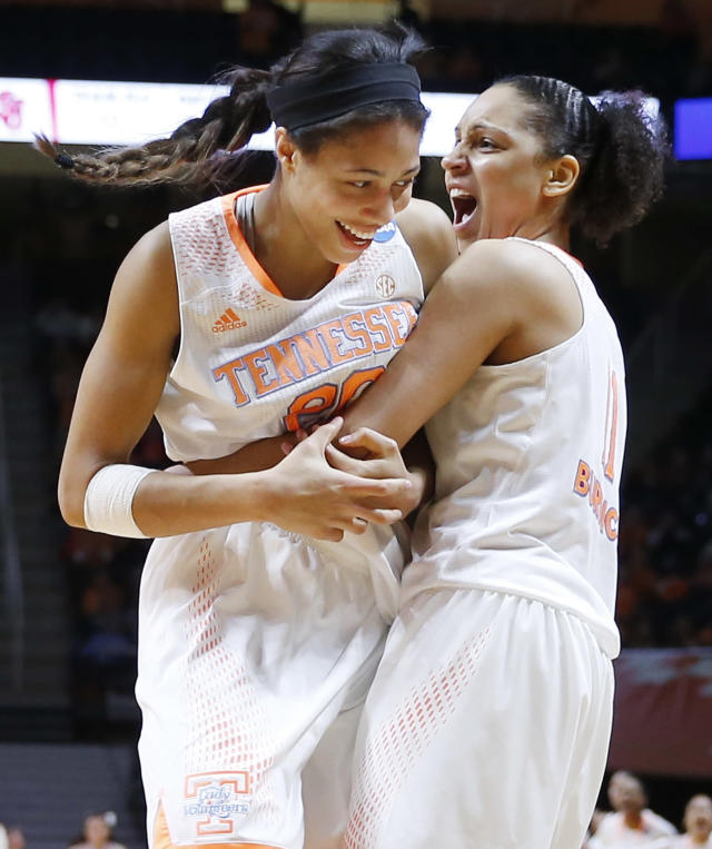 Tennessee's Isabelle Harrison, left, and Cierra Burdick, right, celebrate a score against St. John's in the first half of an NCAA women's college basketball second-round tournament game Monday, March 24, 2014, in Knoxville, Tenn. (AP Photo/John Bazemore)