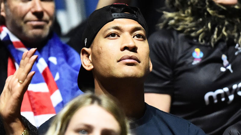 Israel Folau watching a netball game.