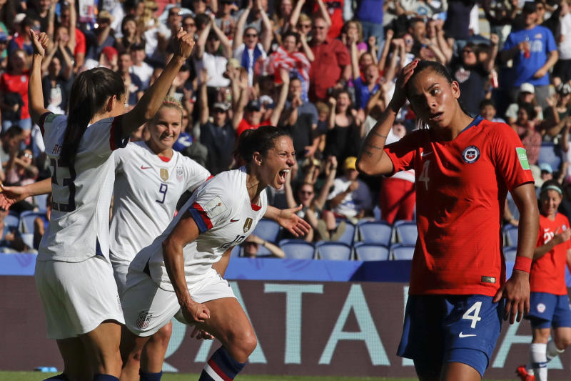 United States' Carli Lloyd, center, celebrates with teammates after scoring their side's third goal during the Women's World Cup Group F soccer match between United States and Chile at Parc des Princes in Paris, France, Sunday, June 16, 2019. (AP Photo/Alessandra Tarantino)