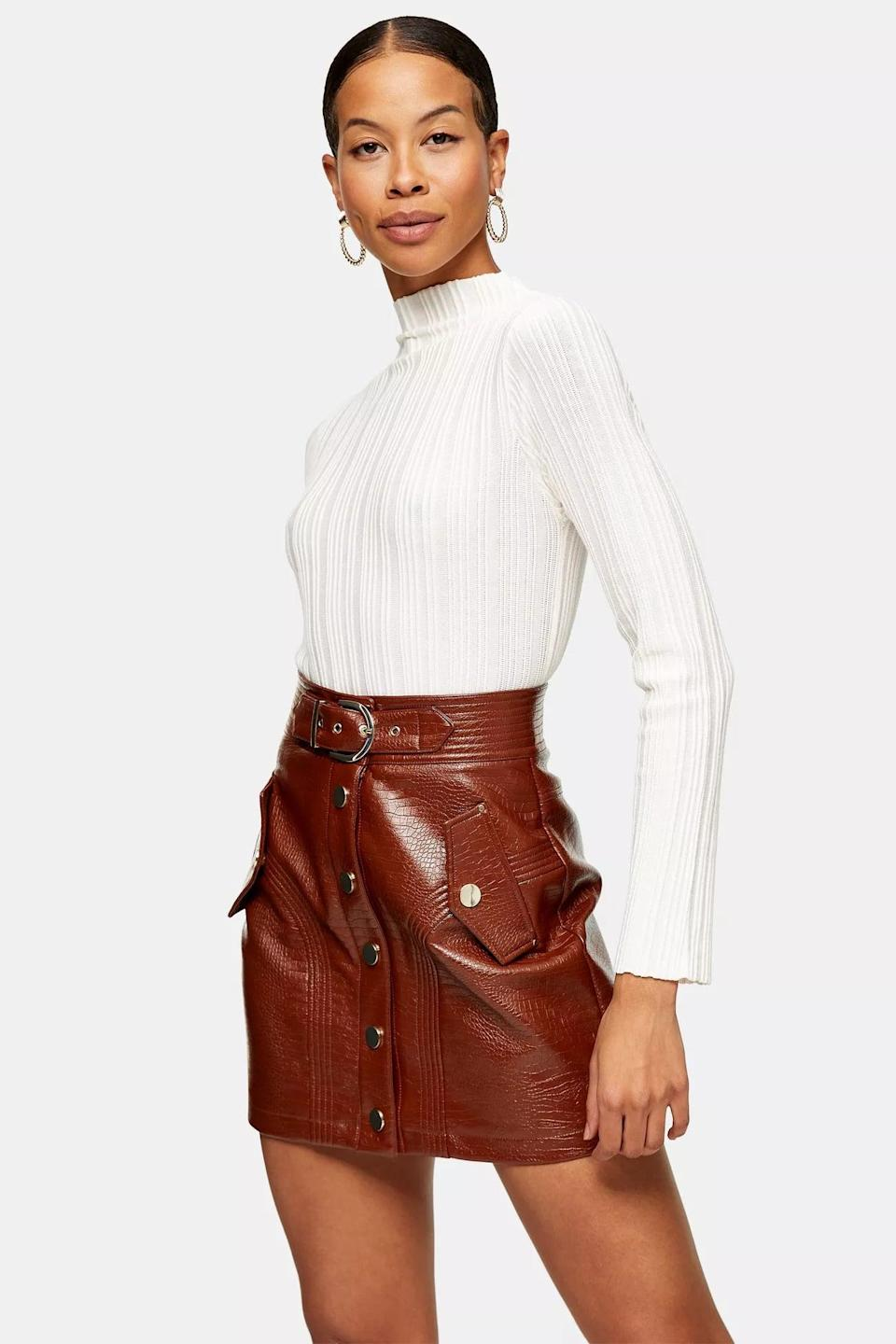 <p>This elegant <span>Ivory Ottoman Knitted Sweater</span> ($35) will take you from the office to dinner in style.</p>