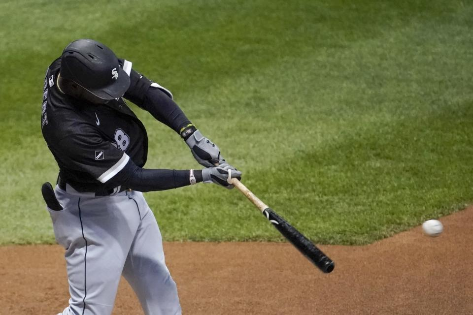 Chicago White Sox's Luis Robert hits a single during the third inning of a baseball game Tuesday, Aug. 4, 2020, in Milwaukee. (AP Photo/Morry Gash)