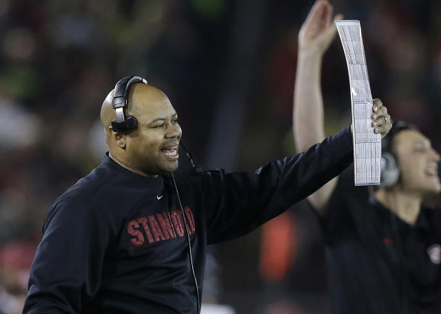 Stanford head coach David Shaw yells from the sideline during the first quarter of an NCAA college football game against Oregon in Stanford, Calif., Thursday, Nov. 7, 2013. (AP Photo/Jeff Chiu)