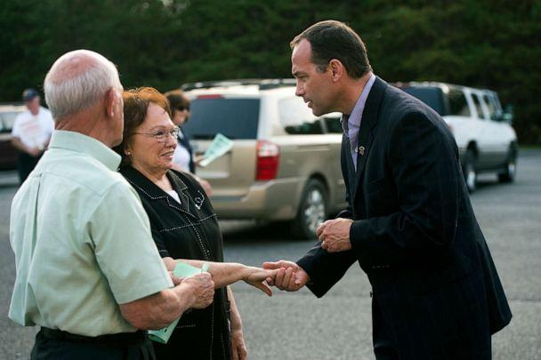 PHOTO: In this Nov. 3, 2015 file photo Republican candidate Bob Good, right, greets voters as they arrive at the Moose Lodge in Lynchburg, Va. (Autumn Parry/The News & Advance via AP)