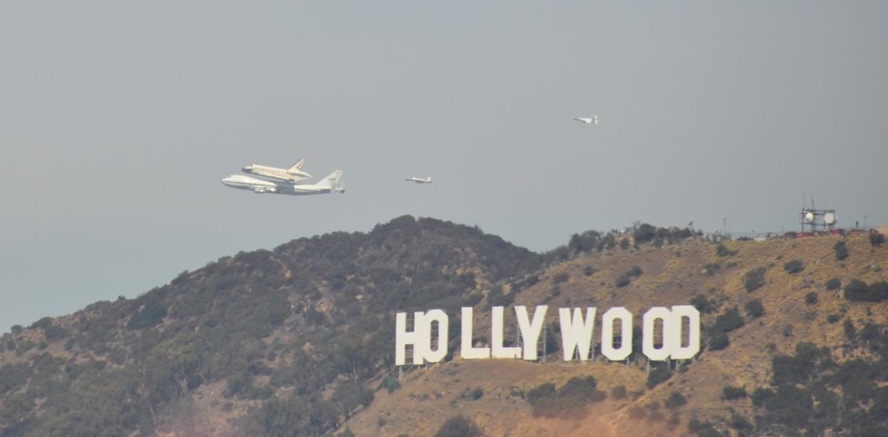 The Endeavour passes over the Griffith Observatory in Los Angeles. Courtesy of Wayne Chan.
