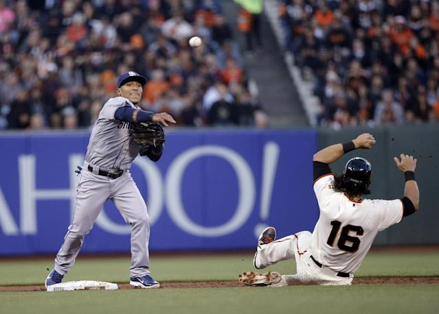 San Diego Padres second baseman Alexi Amarista, left, turns a double play over San Francisco Giants' Angel Pagan (16) on a ground ball from Hunter Pence during the first inning of a baseball game Monday, April 28, 2014, in San Francisco. (AP Photo/Marcio Jose Sanchez)