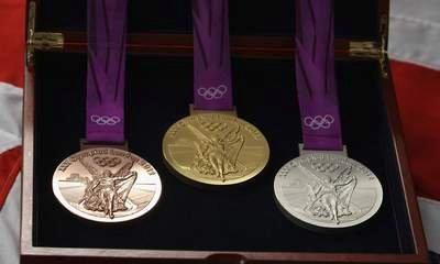 Olympic Medal Maker Sees Profit Dented