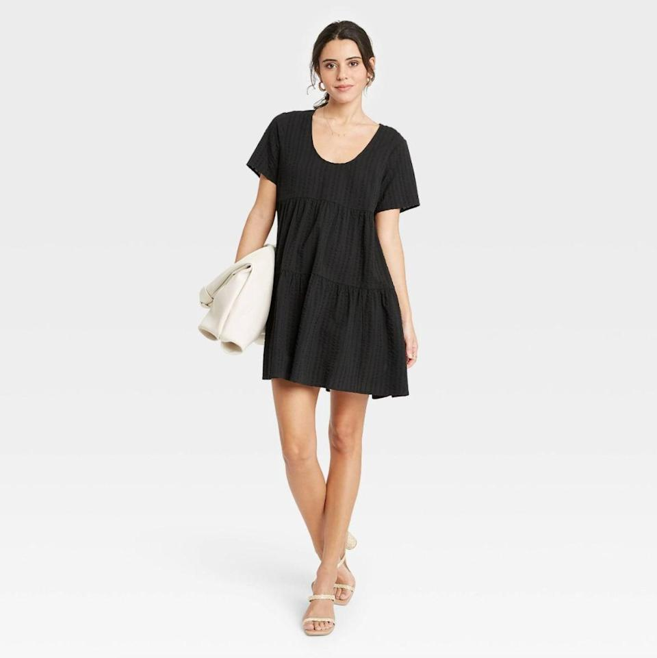 <p>The <span>A New Day Flutter Short Sleeve Tiered Dress in Black</span> ($25) is always a good idea. The versatile pick will take you from day to night.</p>
