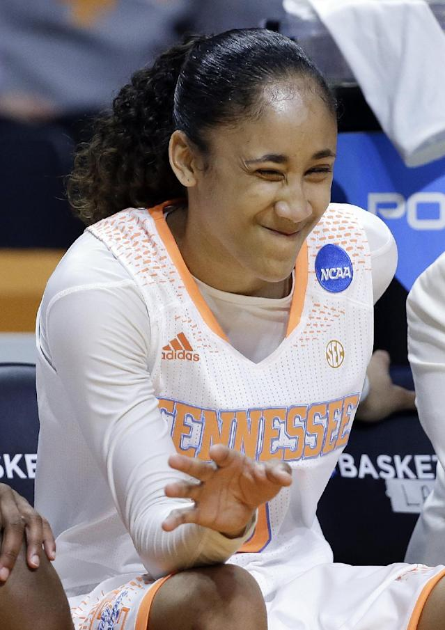Tennessee guard Meighan Simmons winks and waves in the final seconds of the second half of an NCAA women's college basketball second-round tournament game against St. John's Monday, March 24, 2014, in Knoxville, Tenn. Tennessee won 67-51. (AP Photo/Mark Humphrey)