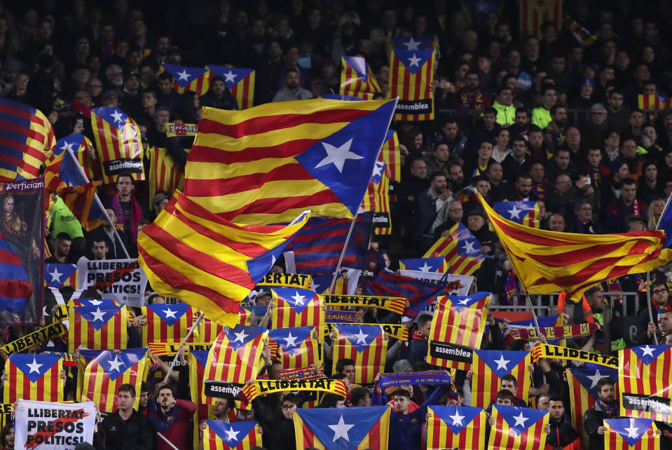 """FILE - In this Feb. 6, 2019 file photo, Barcelona supporters wave Estelada or pro-independence flags during the Copa del Rey semifinal first leg soccer match between FC Barcelona and Real Madrid at the Camp Nou stadium in Barcelona, Spain. Next week's """"clsico"""" between Barcelona and Real Madrid, due to be played on Oct. 26, 2019, has been postponed by the Spanish soccer federation to avoid coinciding with a large separatist rally in riot-stricken Catalonia. (AP Photo/Manu Fernandez, File)"""