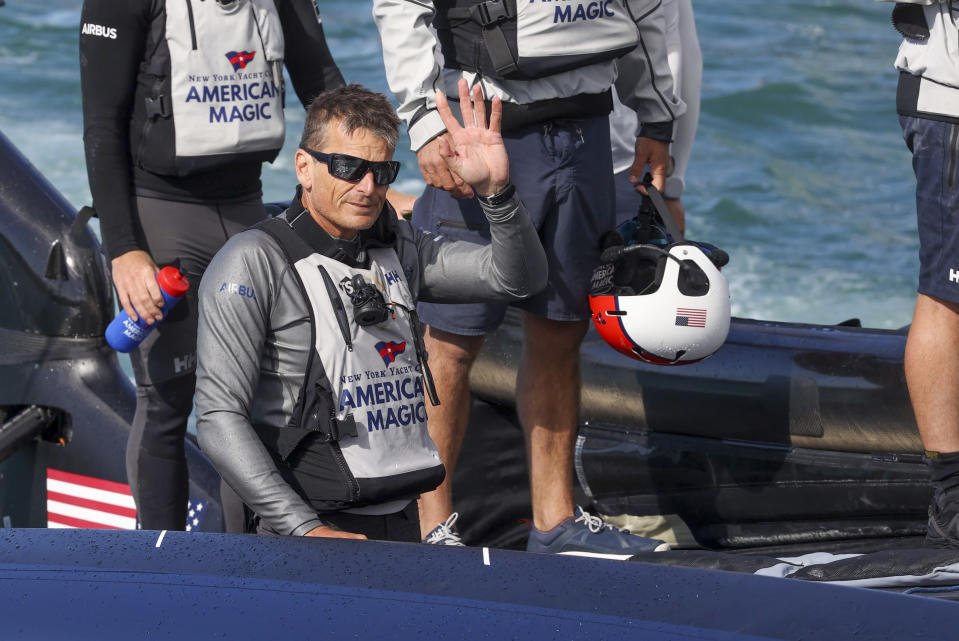 FILE - In this Jan. 30, 2021, file photo, American Magic helmsman, Dean Barker, waves as they return to their team base following their loss to Italy's Luna Rossa in the America's Cup challenger series semifinals on Auckland's Waitemate Harbour, New Zealand. The sting of being the first team eliminated from the 36th America's Cup is going to be with the New York Yacht Club's American Magic for quite some time. American Magic has had a week to ponder the end of its campaign, which was hastened when its yacht, Patriot, capsized and nearly sank during a race in the challenger round-robins on Jan. 17 during a race against Italy's Luna Rose Prada Pirelli Team. (Brett Phibbs/NZ Herald via AP, File)