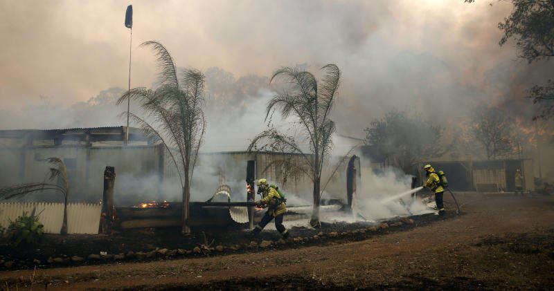 Firefighters save a house on Bullocky Way, Possum Brush, south of Taree in the Mid North Coast region of NSW.