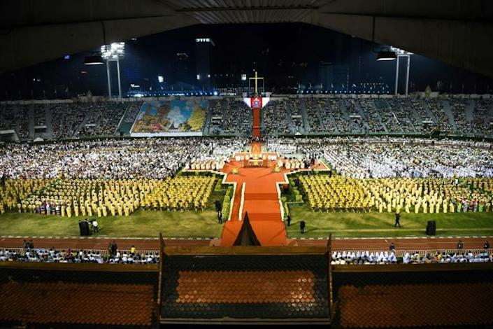 An estimated 60,000 worshippers gathered for the mass (AFP Photo/Mohd RASFAN)