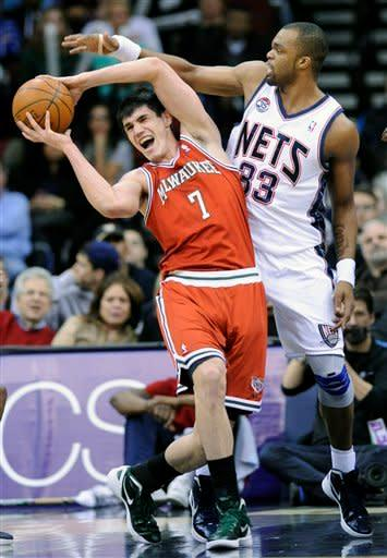 Milwaukee Bucks' Ersan Ilyasova (7), of Turkey, is pressured by New Jersey Nets' Shelden Williams during the first quarter of an NBA basketball game Sunday, Feb. 19, 2012, in Newark, N.J. Ilyasova led all scorers with 29 points as the Bucks defeated the Nets 92-85. (AP Photo/Bill Kostroun)