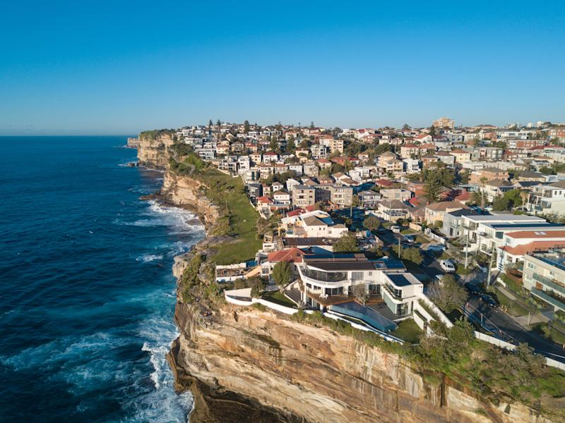 Aerial view of residential area across rock cliff area in Sydney coastline. (Source: Getty)