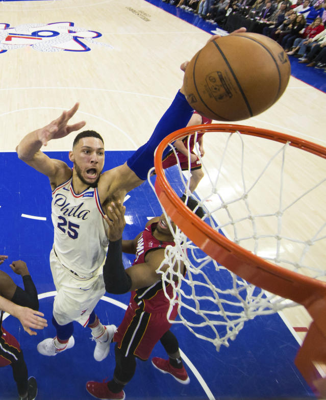 Philadelphia 76ers' Ben Simmons, left, of Australia, shoots over Miami Heat's Hassan Whiteside, right, during the first half in Game 5 of a first-round NBA basketball playoff series, Tuesday, April 24, 2018, in Philadelphia. The 76ers won 104-91. (AP Photo/Chris Szagola)