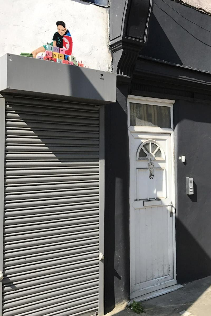 The two-foot artwork appeared on the side of a salon in north London (Pegasus)