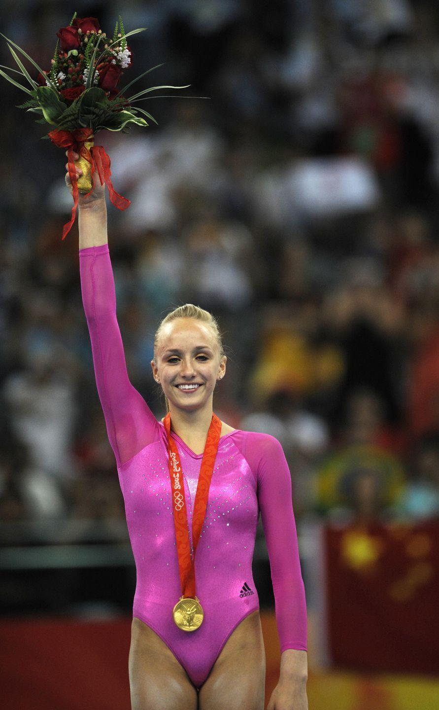 """<p>If there was ever a darling of United States gymnastics, it was Nastia Liukin. The gymnast, whose father is former Olympic athlete Valeri Liukin, competed for the first time on the Olympic stage at the 2008 Summer Games in Beijing. It was there that she took home <a href=""""https://www.britannica.com/biography/Nastia-Liukin"""" rel=""""nofollow noopener"""" target=""""_blank"""" data-ylk=""""slk:five Olympic medals"""" class=""""link rapid-noclick-resp"""">five Olympic medals</a>, including the individual all-around gold medal. </p>"""