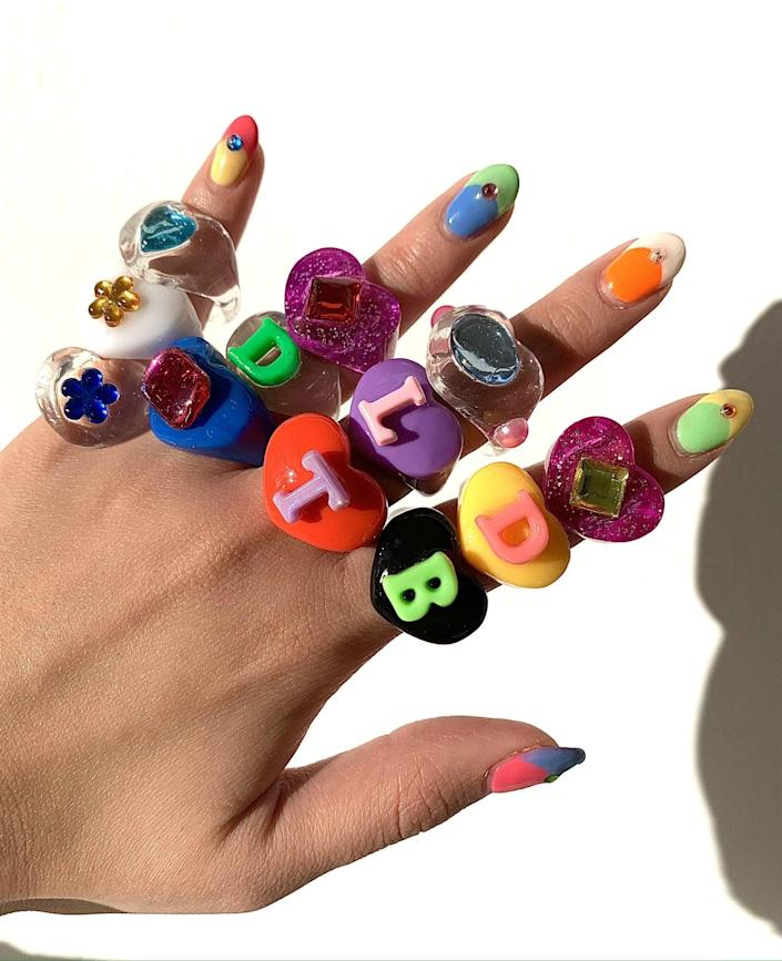 "<p>""<span>BonBonWhims Rainbow Lucky Gems</span> ($45) rings are a bona-fide sensation. Started by Clare Ngai, the whimsical brand will take you right back to the 2000s with its colorful designs. Even <a href=""https://www.popsugar.com/fashion/kylie-jenner-two-toned-versace-top-48184847"" class=""link rapid-noclick-resp"" rel=""nofollow noopener"" target=""_blank"" data-ylk=""slk:Kylie Jenner is a fan"">Kylie Jenner is a fan</a>!"" - NC</p>"