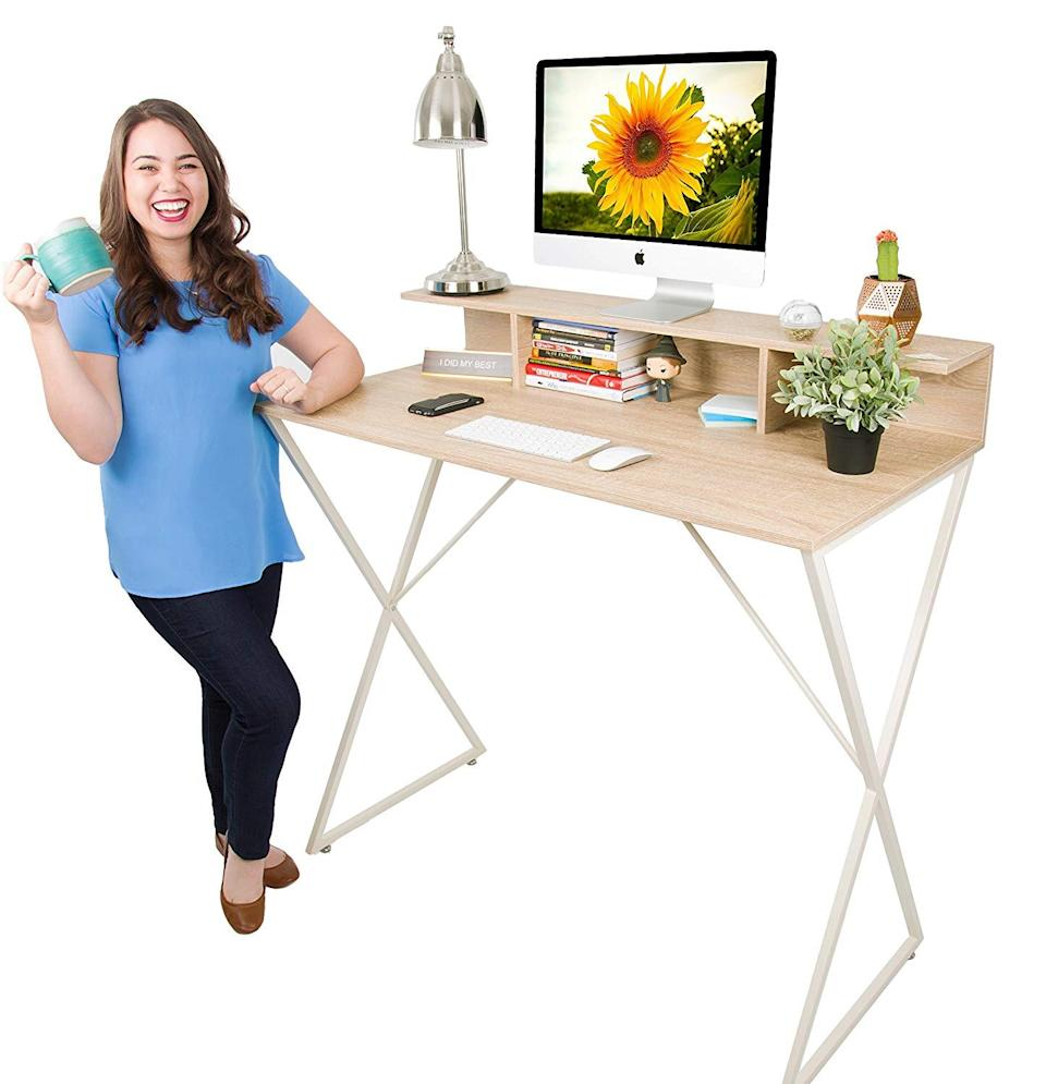 """<h3><strong>Standing Desk Under $150</strong></h3><br><br>This sleek work station is an aesthetically-pleasing option without some of the more technical gadgets offered by other desks. At 41.5 inches with an additional level to keep computer monitors at eye level, this desk is not adjustable. But, with a large work area and the ability to hold up to 60 pounds, it's a great option for someone wanting a more minimal but still functional work space.<br><br><strong><a href=""""https://www.amazon.com/Joy-Desk-Stand-Steady-Workstation/dp/B077J8FHKR/ref=sr_1_16?keywords=standing+desk&qid=1556219589&refinements=p_72%3A2661619011&rnid=2661617011&s=gateway&sr=8-16"""" rel=""""nofollow noopener"""" target=""""_blank"""" data-ylk=""""slk:What people are saying"""" class=""""link rapid-noclick-resp"""">What people are saying</a></strong>: """"I bought this desk as a roll of the dice. When I ordered it there were no reviews, and I wasn't sure about the quality. It is absolutely awesome. No issues what so ever. Well packaged and designed. No issues with assembly. All of the holes matched up and the threads work and were in straight. It is an amazing deal for the price.""""<br><br><strong>Stand Steady</strong> Joy Desk Modern Home Office Standing Desk , $, available at <a href=""""https://www.amazon.com/Joy-Desk-Stand-Steady-Workstation/dp/B077J8FHKR/ref=sr_1_16?keywords=standing+desk&qid=1556219589&refinements=p_72%3A2661619011&rnid=2661617011&s=gateway&sr=8-16"""" rel=""""nofollow noopener"""" target=""""_blank"""" data-ylk=""""slk:Amazon"""" class=""""link rapid-noclick-resp"""">Amazon</a>"""