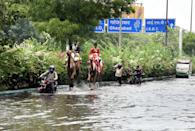 A couple of camels seen along the water logged Ring Road after an early morning heavy rain spell, on July 19, 2020 in New Delhi, India. Moderate-to-heavy rain lashed several states in northern, eastern and coastal India on Sunday, but the monsoon activity continued to remain subdued in Delhi, which has recorded a 40 per cent rainfall deficiency despite an early onset of the seasonal weather system. (Photo By Sonu Mehta/Hindustan Times via Getty Images)
