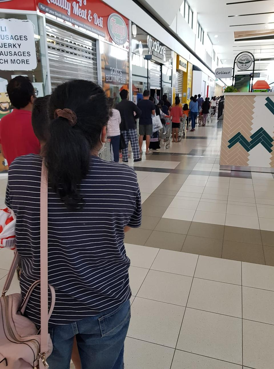 Shoppers waited in lengthy queues to get their hands on the bargain Special Buys. Photo: Facebook.