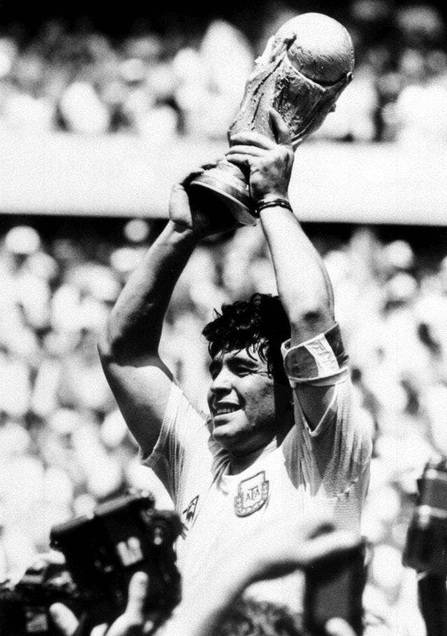 Diego Maradona holds the World Cup aloft after victory for Argentina in the 1986 final