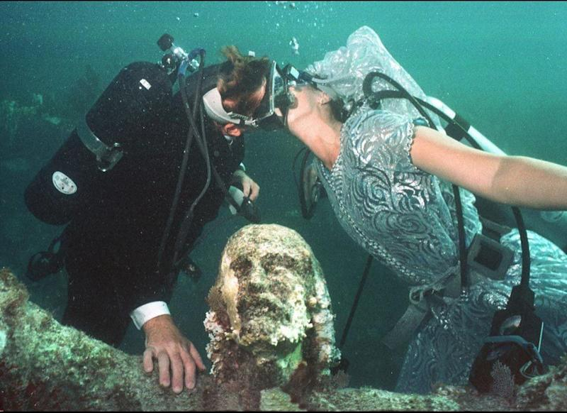 There wasn't a dry eye in the house during the underwater wedding of Bob Woodberry and Emily Johnson in the Florida Keys on Aug. 22, 1998. The lovebirds dove into holy matrimony in the depths of Key Largo, right next to a bronze 'Christ of the Deep' statue. Amen to that.