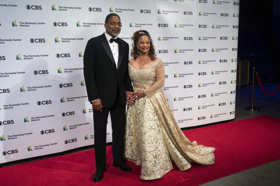 2020 Kennedy Center honoree, choreographer, and actress Debbie Allen and Norman Nixon attend the 43nd Annual Kennedy Center Honors at The Kennedy Center on Friday, May 21, 2021, in Washington. (AP Photo/Kevin Wolf)