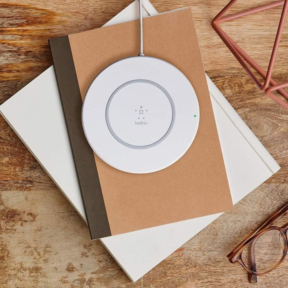 """<p>Charge your phone with ease thanks to this <a href=""""https://www.popsugar.com/buy/Belkin-Boost-Up-Wireless-Charging-Pad-390419?p_name=Belkin%20Boost%20Up%20Wireless%20Charging%20Pad&retailer=amazon.com&pid=390419&price=33&evar1=geek%3Aus&evar9=36026397&evar98=https%3A%2F%2Fwww.popsugar.com%2Ftech%2Fphoto-gallery%2F36026397%2Fimage%2F45606324%2FBelkin-Boost-Up-Wireless-Charging-Pad&list1=tech%2Cshopping%2Cgifts%2Camazon%2Choliday%2Cgift%20guide%2Cdigital%20life%2Cblack%20friday%2Ccyber%20monday%2Ctech%20shopping%2Cblack%20friday%20sales%2Ctech%20gifts%2Cgifts%20for%20men%2Csales%20and%20deals&prop13=mobile&pdata=1"""" class=""""link rapid-noclick-resp"""" rel=""""nofollow noopener"""" target=""""_blank"""" data-ylk=""""slk:Belkin Boost Up Wireless Charging Pad"""">Belkin Boost Up Wireless Charging Pad</a> ($33) that works with Apple, Samsung, LG, Sony, and more.</p>"""