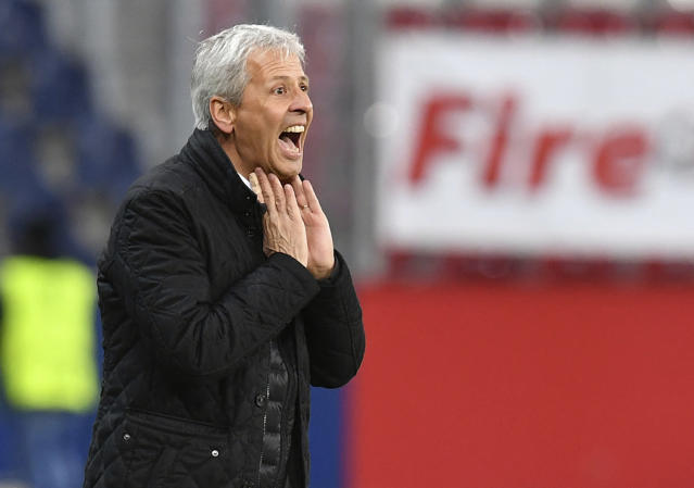 FILE - In this Thursday, Oct 20, 2016 file photo, Nice head coach Lucien Favre shouts to his players during the Europa League group I soccer match between Salzburg and Nice in Salzburg, Austria. Borussia Dortmund has signed Lucien Favre as coach from French side Nice. The Bundesliga club says Tuesday, May 22, 2018 the 60-year-old Favre, who previously coached league rivals Borussia Moenchengladbach and Hertha Berlin, has signed a deal through June 2020. (AP Photo/Kerstin Joensson, File)