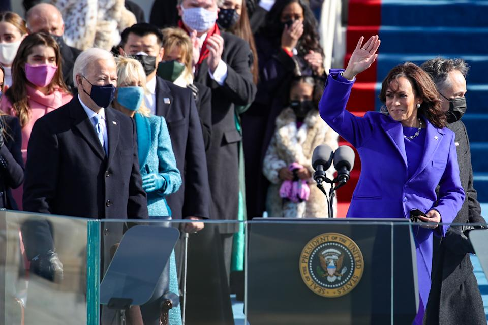 WASHINGTON, DC - JANUARY 20: Newly sworn in Vice President Kamala Harris waves to the crowd during the inauguration of U.S. President-elect Joe Biden on the West Front of the U.S. Capitol on January 20, 2021 in Washington, DC. During today's inauguration ceremony Joe Biden becomes the 46th president of the United States. (Photo by Rob Carr/Getty Images)