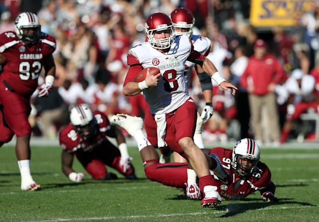 COLUMBIA, SC - NOVEMBER 10: Tyler Wilson #8 of the Arkansas Razorbacks runs away from J.T. Surratt #97 of the South Carolina Gamecocks during their game at Williams-Brice Stadium on November 10, 2012 in Columbia, South Carolina. (Photo by Streeter Lecka/Getty Images)