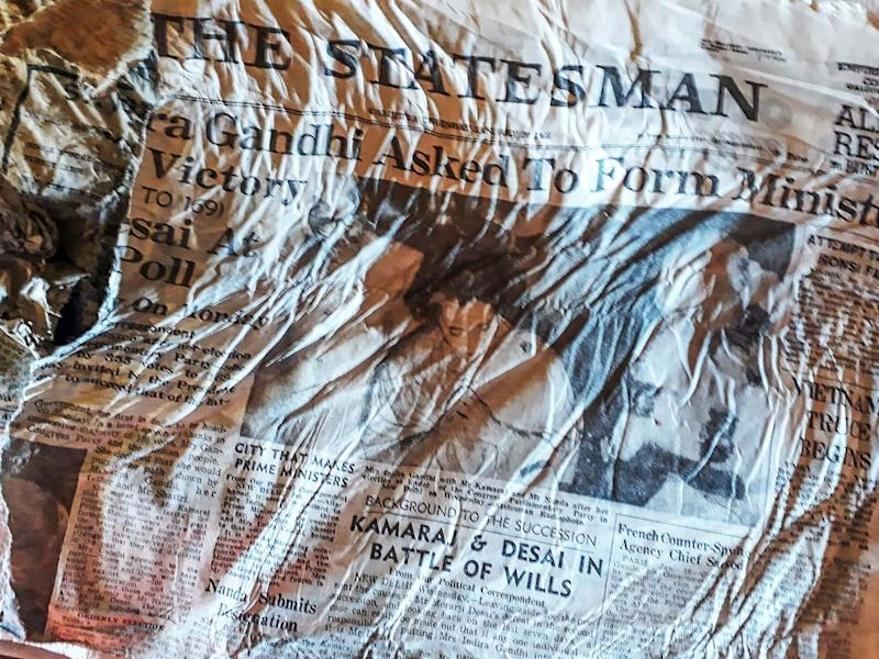 A 1966 copy of Indian newspaper The Statesman with a headline announcing the election of Indira Gandhi, likely to have been on board the Air India Boeing 707 that crashed in the nearby Mont Blanc massif in January 1966. The papers emerged as the Bossons glacier in the French Alps rapidly melts: BERNARD BARRON/AFP via Getty Images