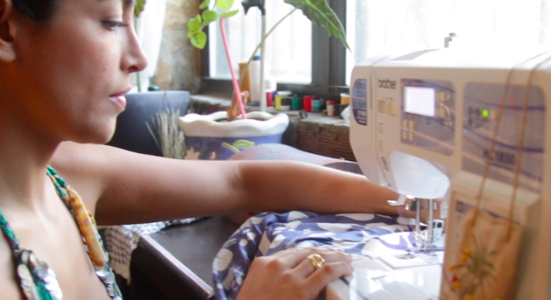 Dress designer Diana Osario sewing dresses she designs from her Brooklyn apartment. The founder of conamorbydiana.com says her business was impacted by the pandemic.