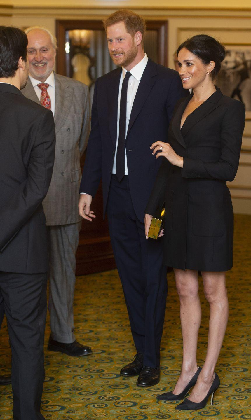 <p>Yet again, Meg's legs caused a stir. This time, it was the tuxedo dress the Duchess wore to a performance of <em>Hamilton </em>that had people saying she broke protocol with a short hem. </p>