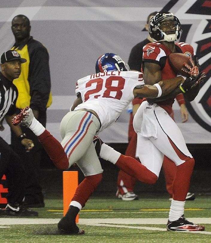 Atlanta Falcons wide receiver Julio Jones (11) makes a touchdown catch as New York Giants cornerback Jayron Hosley (28) defends during the second half of an NFL football game on Sunday, Dec. 16, 2012, in Atlanta. (AP Photo/John Amis)