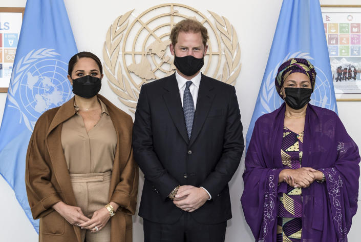 In this photo provided by the United Nations, U.S. Deputy Secretary-General Amina Mohammed, right, Meghan Markle, left, and Prince Harry stand together for a photo during a visit to U.N. headquarters during the the 76th session of the United Nations General Assembly on Saturday, Sept. 25, 2021. (Manuel Elías/U.N. via AP)