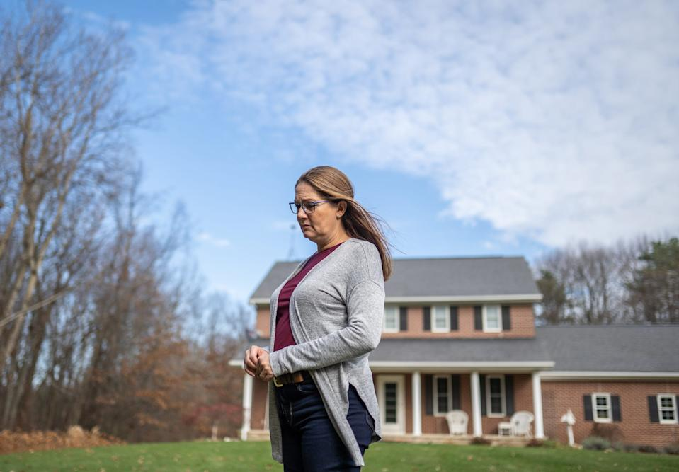 Pam Warfle sits outside of her home in Perry, Michigan, on Nov. 20, 2020.