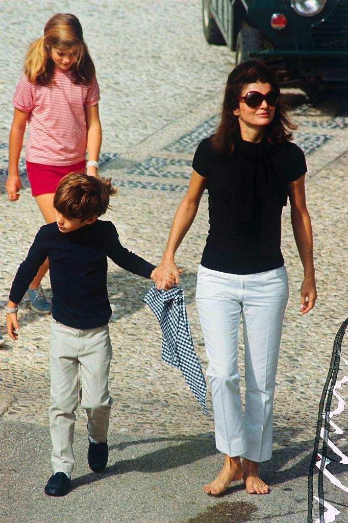<p>The day before her wedding to Aristotle Onassis, Jackie is seen wearing a black top and white pants as she walks with Caroline and John Jr.<br></p>