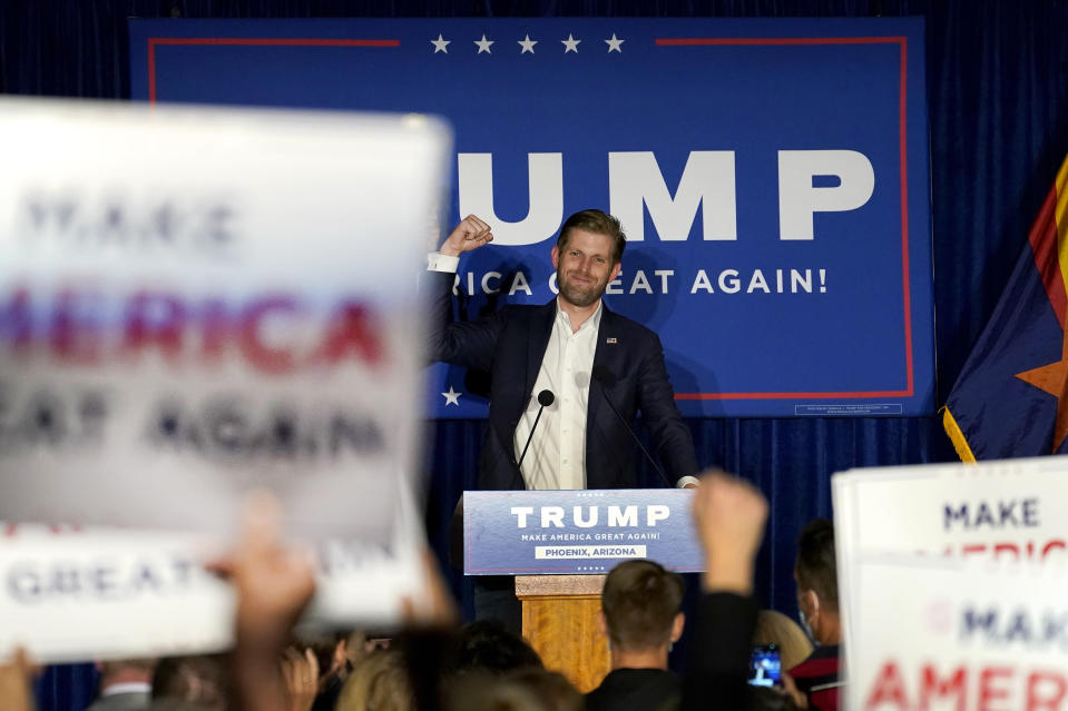 Eric Trump, son of President Donald Trump, speaks with supporters at a campaign rally, Monday, Oct. 26, 2020, in Phoenix. (AP Photo/Matt York)