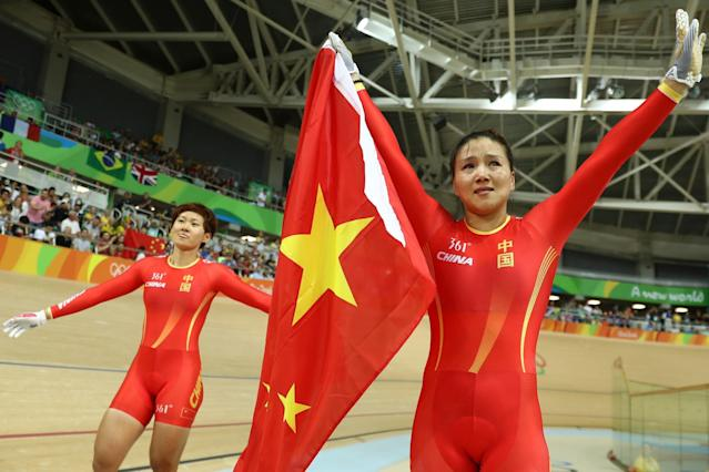 <p>Jinjie Gong (R) and Tianshi Zhong (L) of Team China celebrates winning the gold medal after beating Team Russia in the Women's Team Sprint final for gold on Day 7 of the Rio 2016 Olympic Games at the Rio Olympic Velodrome on August 12, 2016 in Rio de Janeiro, Brazil. (Photo by Bryn Lennon/Getty Images) </p>