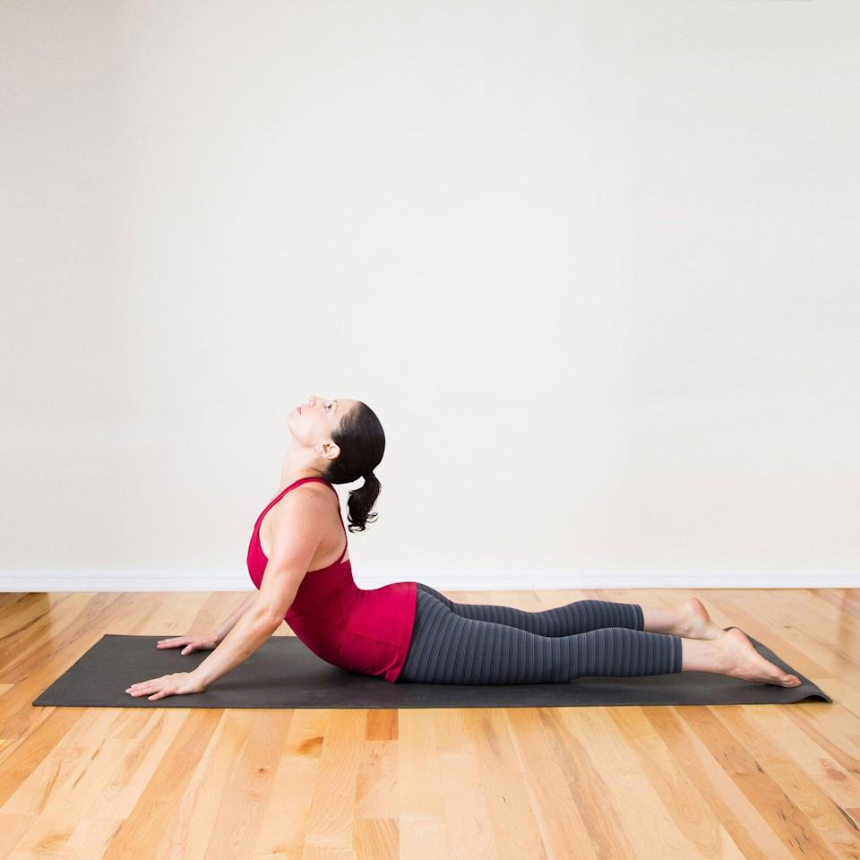 <ul> <li>Lie on your stomach with the legs straight behind you. Place your palms on the ground by your armpits, elbows bent behind you.</li> <li>Push through your hands to slowly lift your head and shoulders off the ground, arching your back while keeping your hips and thighs on the ground. Arch back as far as is comfortable, keeping your elbows slightly bent to lessen the stretch and straightening them to intensify it.</li> <li>Actively roll your shoulders back and down away from your ears, elongating your neck. Keep looking in front of you, or if you want more of a chest stretch, drop your head back between your shoulder blades. Stay here for a few breaths.</li> <li>Slowly lift your hips and shift your butt back until it rests on your heels, bowing your back and coming into Child's Pose. Your arms should be straight out in front of you, palms pressing into the ground. Stay here for a few breaths.</li> <li>Lift your hips again and shift forward to return to Cobra Pose.</li> <li>Move slowly between the two poses for 30 seconds.</li> </ul>