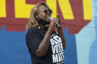 LaTosha Brown, co-founder of Black Voters Matter, speaks on voting rights at the John Lewis Advancement Act Day of Action, a voter education and engagement event, Saturday, May 8, 2021, at King's Canvas in Montgomery, Ala. (AP Photo/Vasha Hunt)