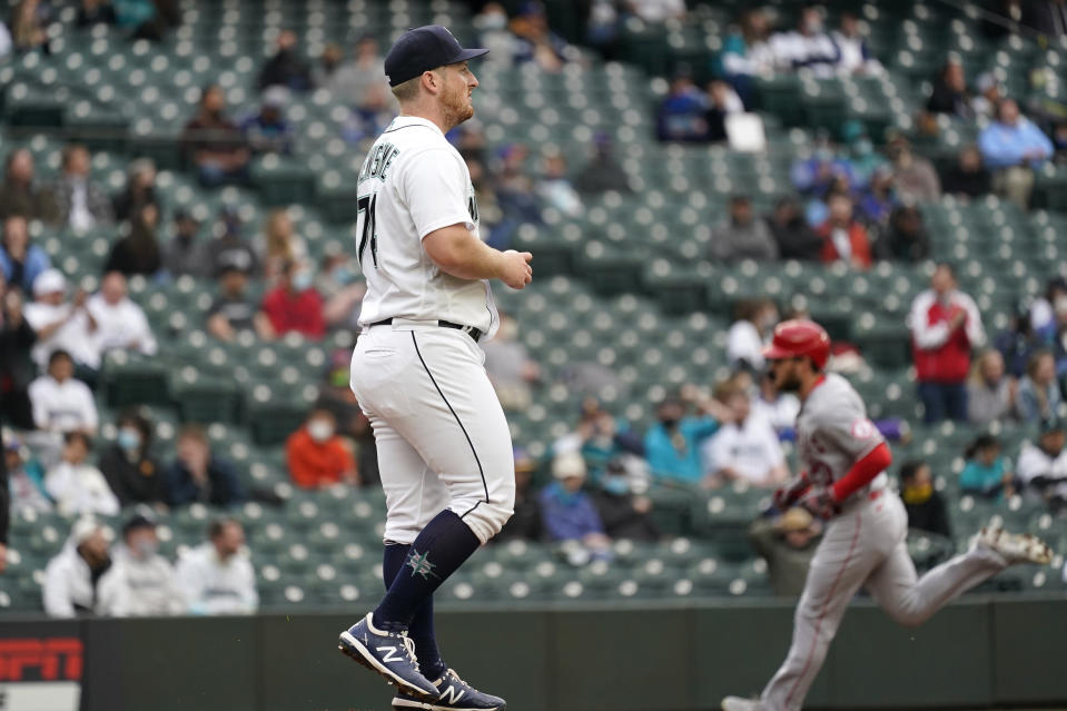 Seattle Mariners starting pitcher Ljay Newsome waits as Los Angeles Angels' Jared Walsh circles the bases on a solo home run during the second inning of a baseball game Saturday, May 1, 2021, in Seattle. (AP Photo/Elaine Thompson)