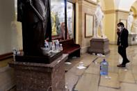 <p>Water bottles and trash were left strewn about the Capitol building after rioters breached security on Jan. 6. </p>