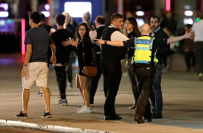 """<p>A Police officer clears people away from the area near London Bridge after an incident in central London, late Saturday, June 3, 2017. British police said they were dealing with """"incidents"""" on London Bridge and nearby Borough Market in the heart of the British capital Saturday, as witnesses reported a vehicle veering off the road and hitting several pedestrians. (AP Photo/ Matt Dunham) </p>"""