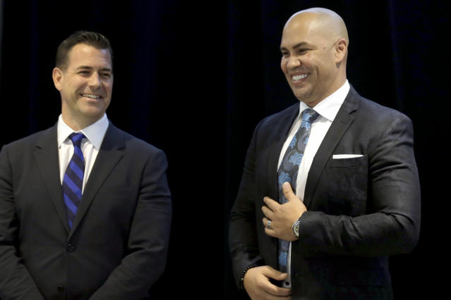 FILE - In this Nov. 4, 2019, file photo, New York Mets new manager, Carlos Beltran, right, laughs with general manager Brodie Van Wagenen at the start of an introductory baseball news conference at Citi Field in New York. Beltran is out as manager of the Mets. The team announced the move Thursday, Jan. 16, 2020. (AP Photo/Seth Wenig, File)