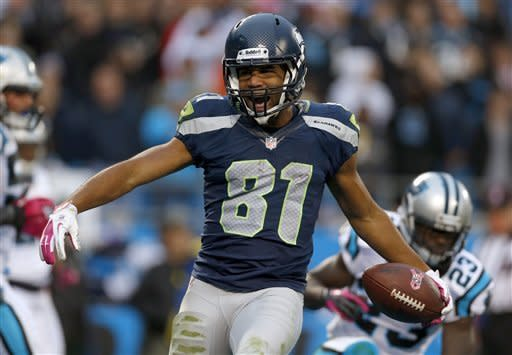 Seattle Seahawks' Golden Tate (81) reacts after his touchdown catch against the Carolina Panthers during the third quarter of an NFL football game in Charlotte, N.C., Sunday, Oct. 7, 2012. (AP Photo/Bob Leverone)